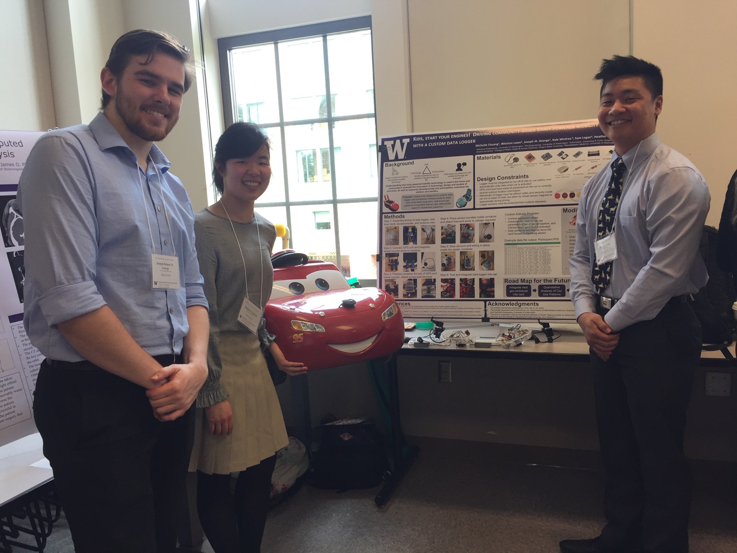 Joseph, Michelle, and Winston rocking their poster presentation!